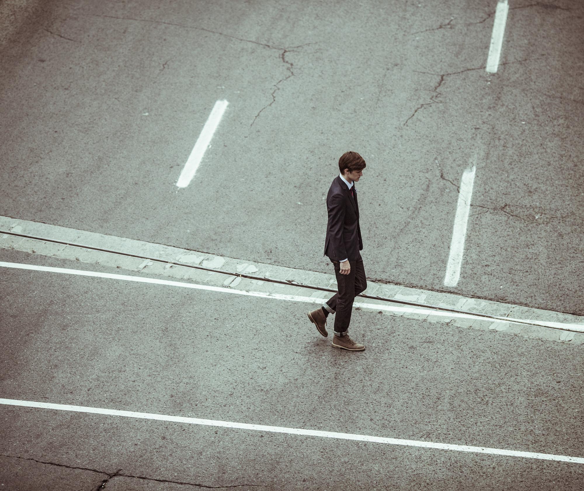 Dude Walkin by Alejandro Escamilla from Unsplash.com