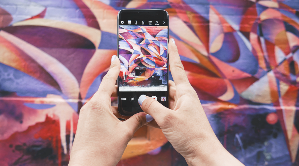 Android phone taking photo of colorful wall - From https://unsplash.com/photos/KGcLJwIYiac